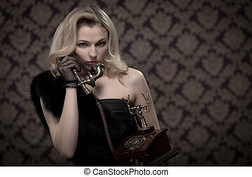 Blond woman talking on the phone. Retro portrait