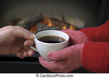 Hand warming at a fireplace