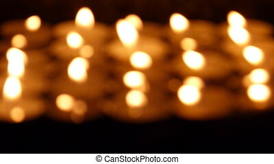 candles - out of focus light of candles in the dark