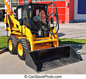 skid steer loader - Loader a tractor close up on grey...