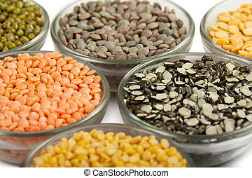 Grains pulses and beans in bowl isolated over white over