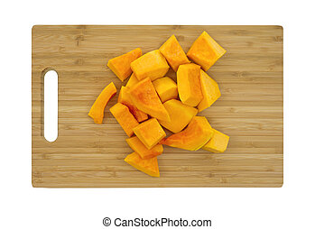 Butternut squash on cutting board - Several pieces of cut...
