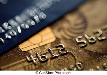 credit cards - two credit cards, narrow focus. closeup.