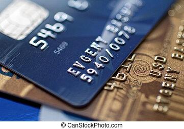 Credit card - two credit cards, narrow focus. closeup.