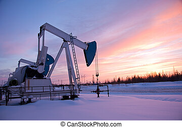 pumpjack - oil pump on the sunset sky background