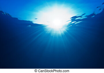 Abstraction with water and sun rays. underwater view.