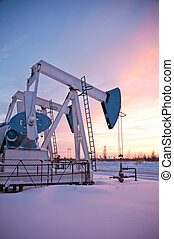 pumpjack - oil pumps on the sunset sky background