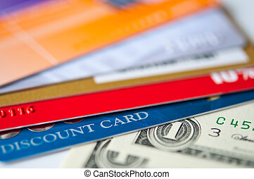 plastic cards and money - bright plastic discount cards and...