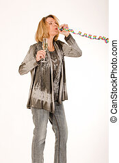 older women partying - older woman blows out a streamer and...