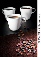 three coffee cups - three white cups ,coffee beans and...