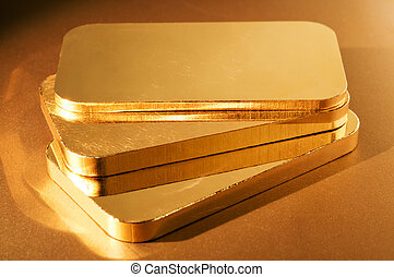 Gold Ingots - three gold ingots on a golden background...
