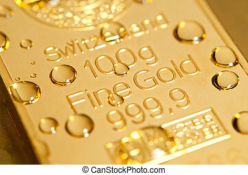 drops on a gold ingot - gold ingot and water drops...