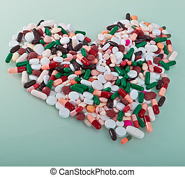 various pills in a shape of heart - colorful pills in a...