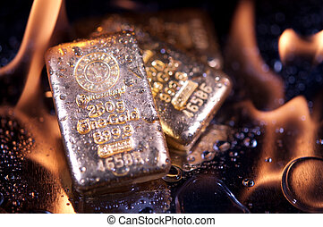 goldbars and flame - gold bullion and flame. safe...