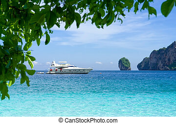 White motor yacht on the background of turquoise water and...