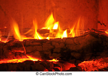 Flames - Burning wood in the fireplace and the flames