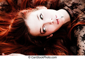 woman with cigarette - beautiful redhead woman portrait with...
