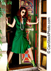 fashion woman - red hair woman in elegant green dress in...