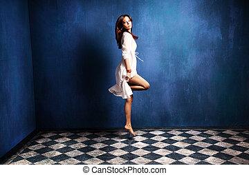 levitation woman - beautiful barefoot woman in white dress...