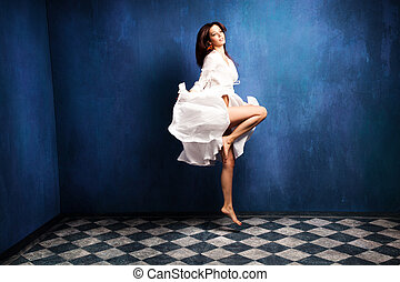 levitation woman - beautiful barefoot woman in white dress...