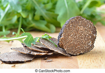 Fresh black truffles - Italian black truffles on a wooden...