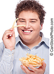 chubby man with pommes frites - Happy young chubby man with...