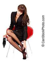 Feet massage - pretty business woman relaxing her feet with...