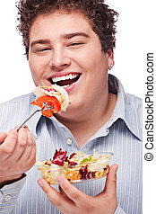 chubby man with fresh salad