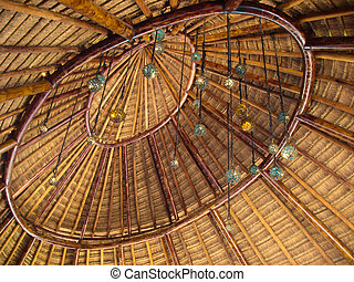 Palapa Roof - The indoor section of a palapa roof decorated...