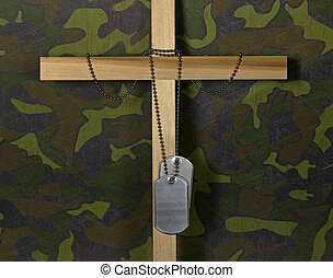 Dog tags on cross - Military dog tags hanging from a wooden...
