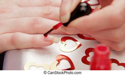 Woman paints the nails