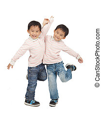 happy asian boys dancing together