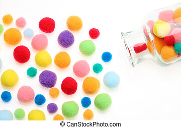 cotton balls - Colorful cotton balls on a white background