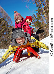 Winter fun - Happy friends in winterwear looking at camera...