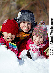 Friends in snow - Happy friends in winterwear playing in...