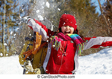 Winter joy - Happy friends in winterwear playing with snow...