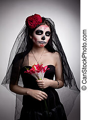 Serious woman in skull face art mask and flowers - Young...