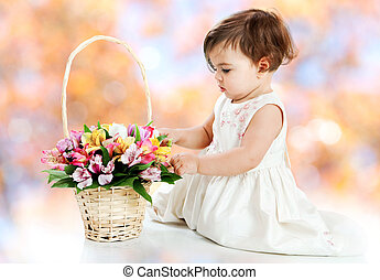 Little girl and flower basket on white background
