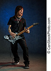 Brutal man playing electric guitar with passion