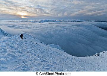 climbing the mountain in winter - a climber on the mountain...