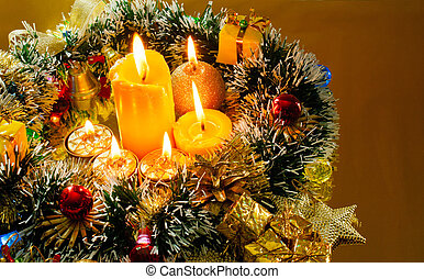 Christmas carol and burning candles over golden background