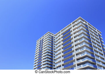 Modern, apartments and with deep blue spring sky