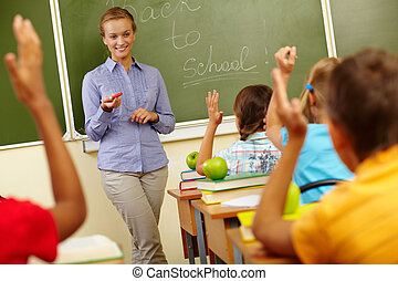 Beginning of school year - Portrait of smart teacher by...