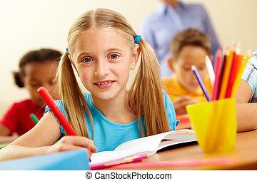 Schoolgirl - Portrait of lovely schoolgirl looking at camera...