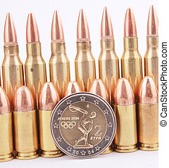 2 Euro coin - A 2 Euro coin with 9mm and 5.56mm cartridges