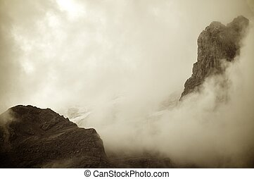 fog - a  view of rocky pinnacles in the Pyrenees