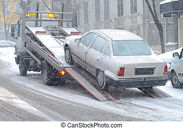 Car breakdown and towing assistance at snowy day
