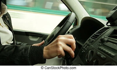At The Wheel - Woman behind the wheel in urban driving...