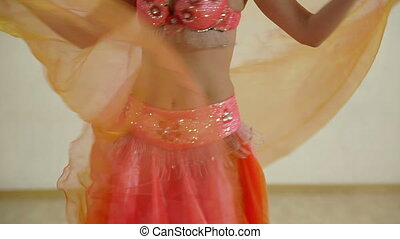 belly dancer - Belly of the woman dancing in the orange...