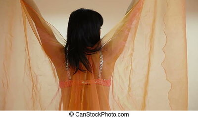 Woman Perform a Belly Dance - Woman perform belly dance at...